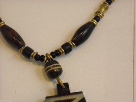 Handcrafted Beaded Necklace with Tribal Wood Carving by Kenyan Artist image 4