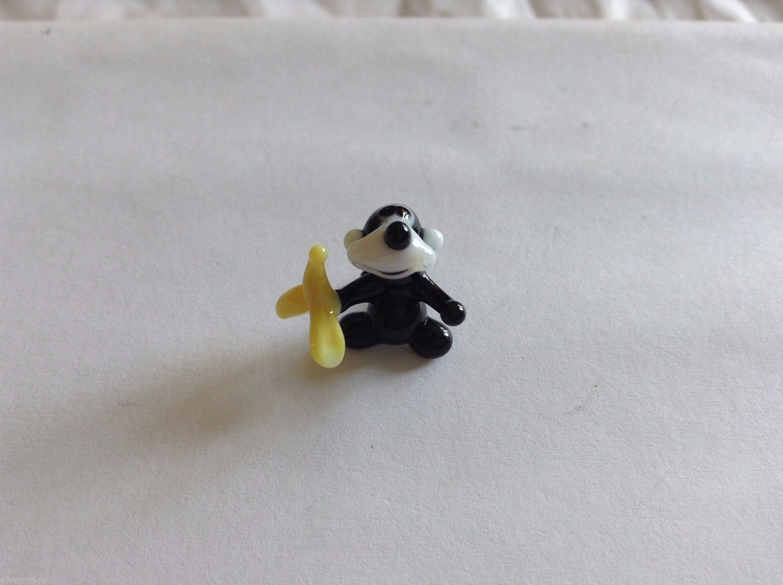 Micro Miniature small hand blown glass made USA black monkey holding banana