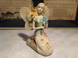Kneeling Angel with Bouquet Mira Flora Handcrafted Resin Angel Figurine - $39.99