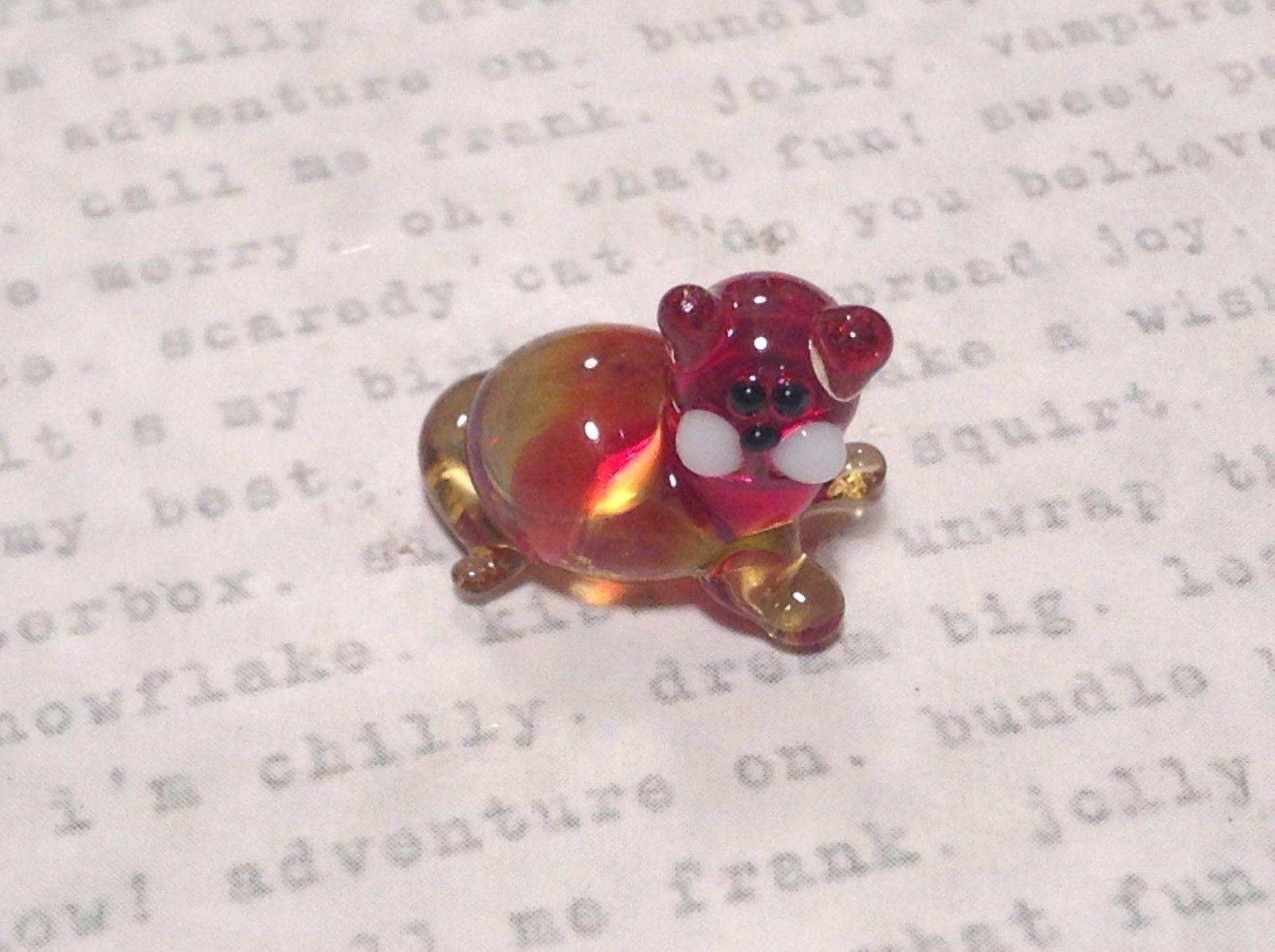 Micro miniature small hand blown red  amber cat lying down   USA  NIB