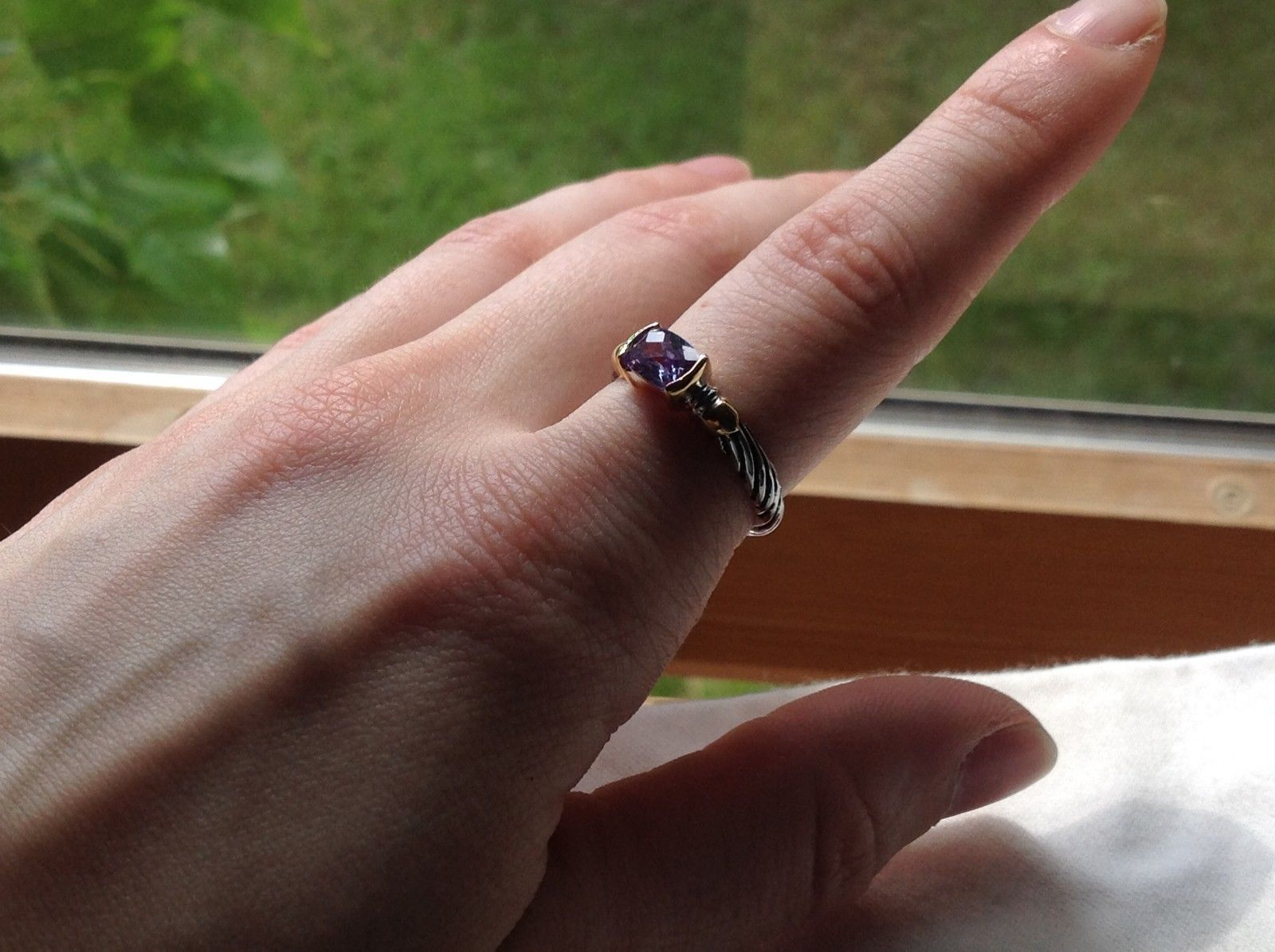 Lavender CZ baguette set in 18K yellow and white gold plated ring