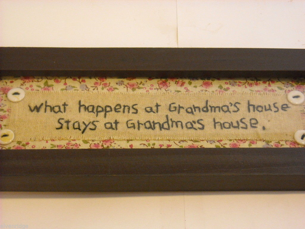 New primitive embroidered framed What happens at Grandma's house stays at