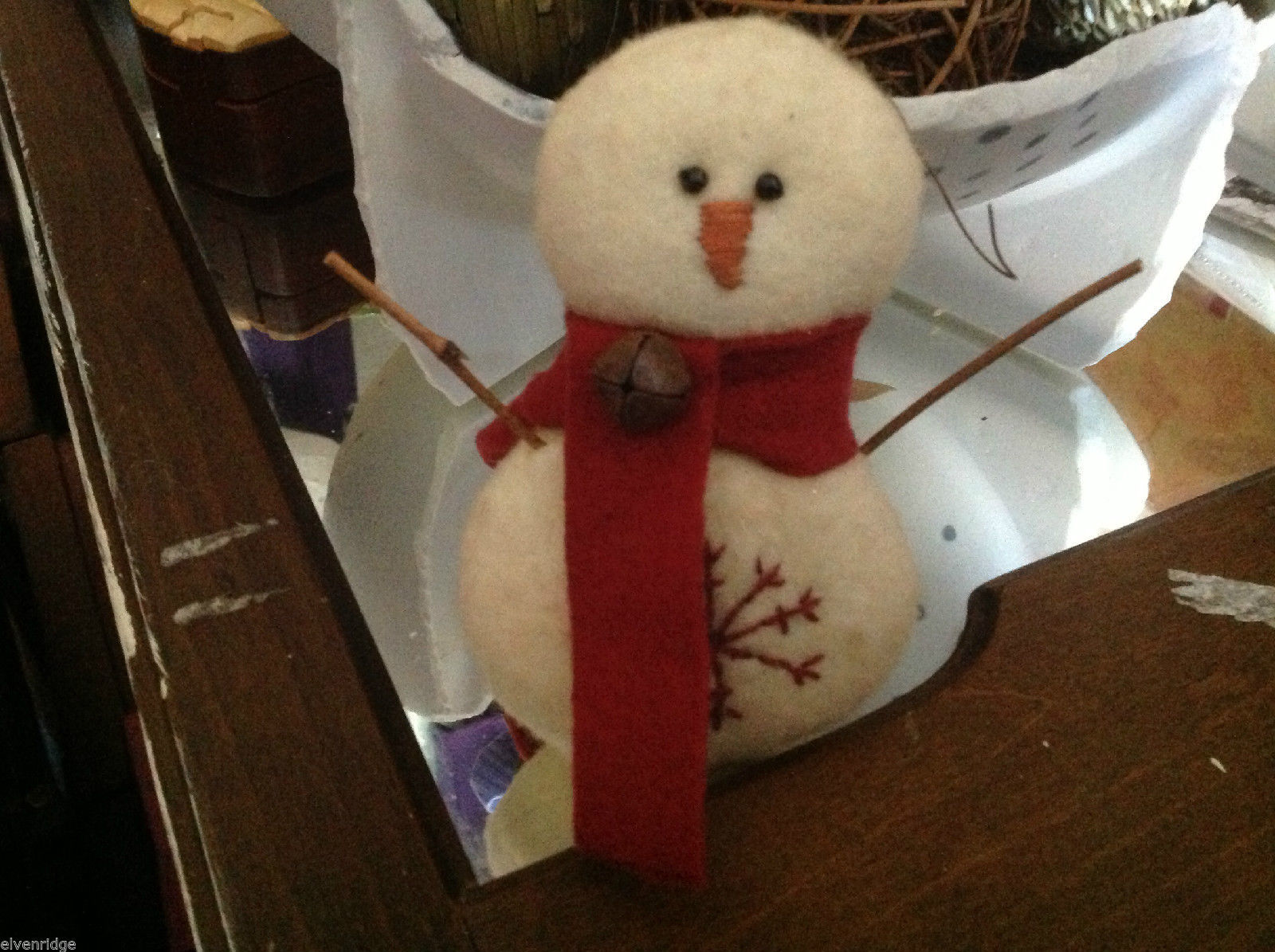 New puffy white snowman ornament with stitched snowflake scarf and stick arms