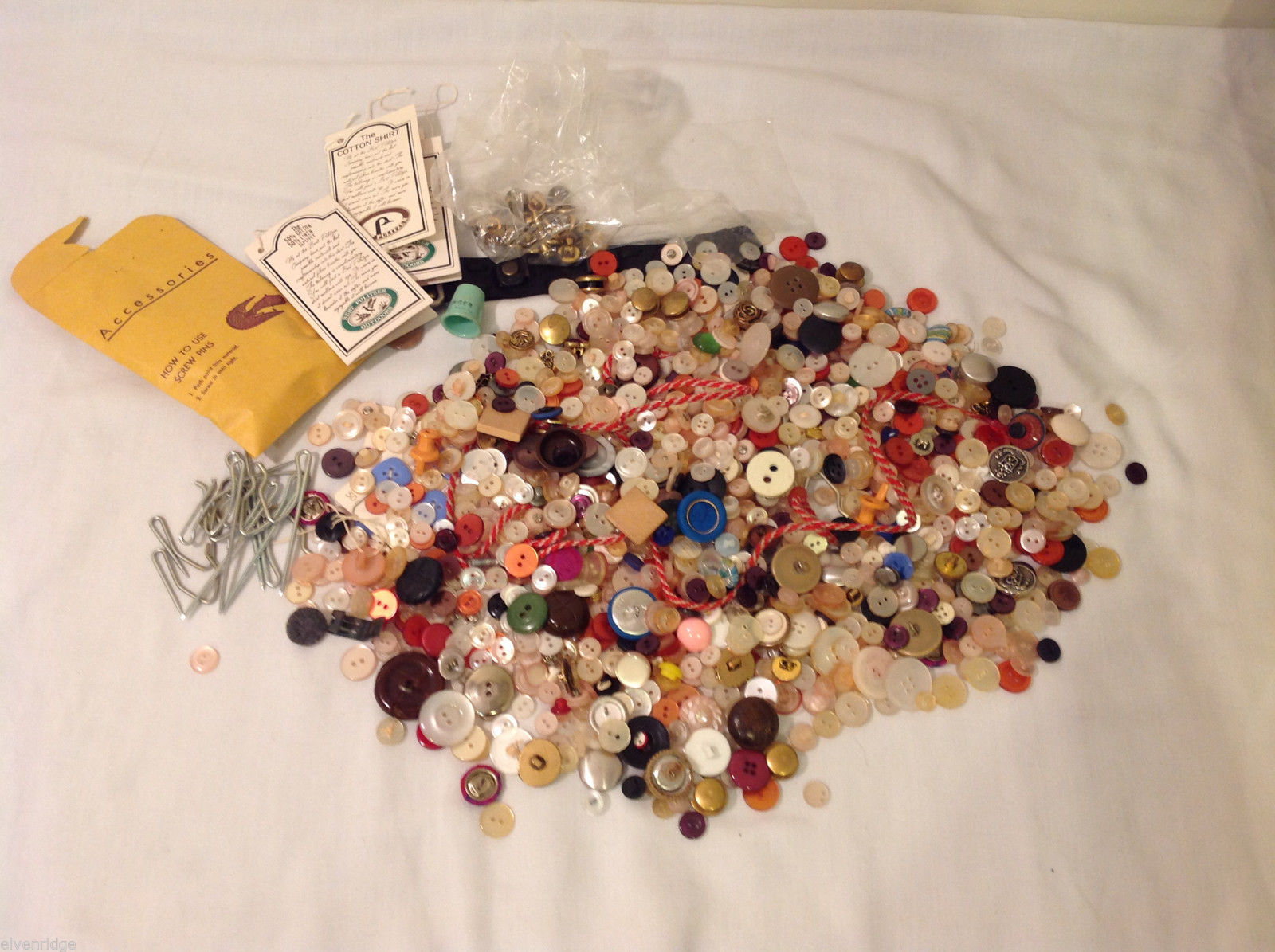 Lot of Different kind of buttons and materials for sewing and crafting