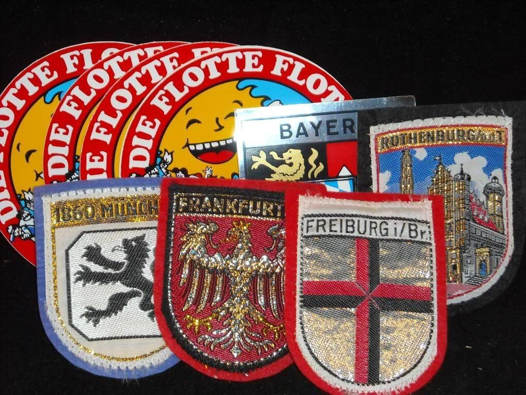 Lot of felt german family crests + cruise stickers
