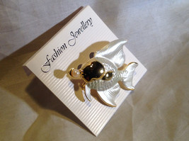 Lovely Gold Tone Fish with a Pearl Pin Clasp Closure