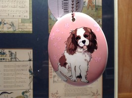 Oval Ceramic Cavalier Dog Pink Background Ornament with Metal Chain Department56 image 1
