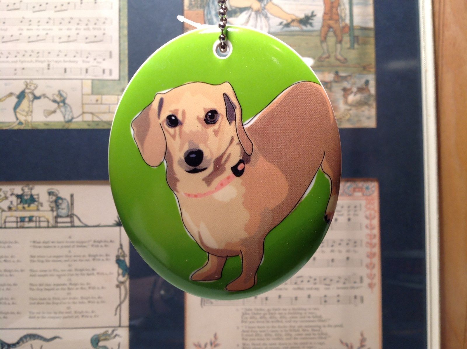 Oval Ceramic Dachshund Dog Green Background Ornament w Metal Chain Department 56