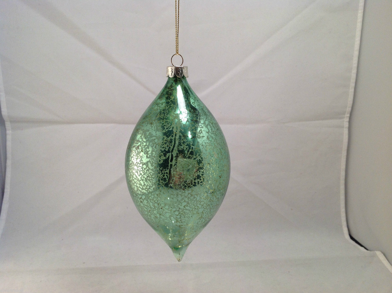 Metallic and Clear Blown glass Football Shaped Holiday ornament, light green