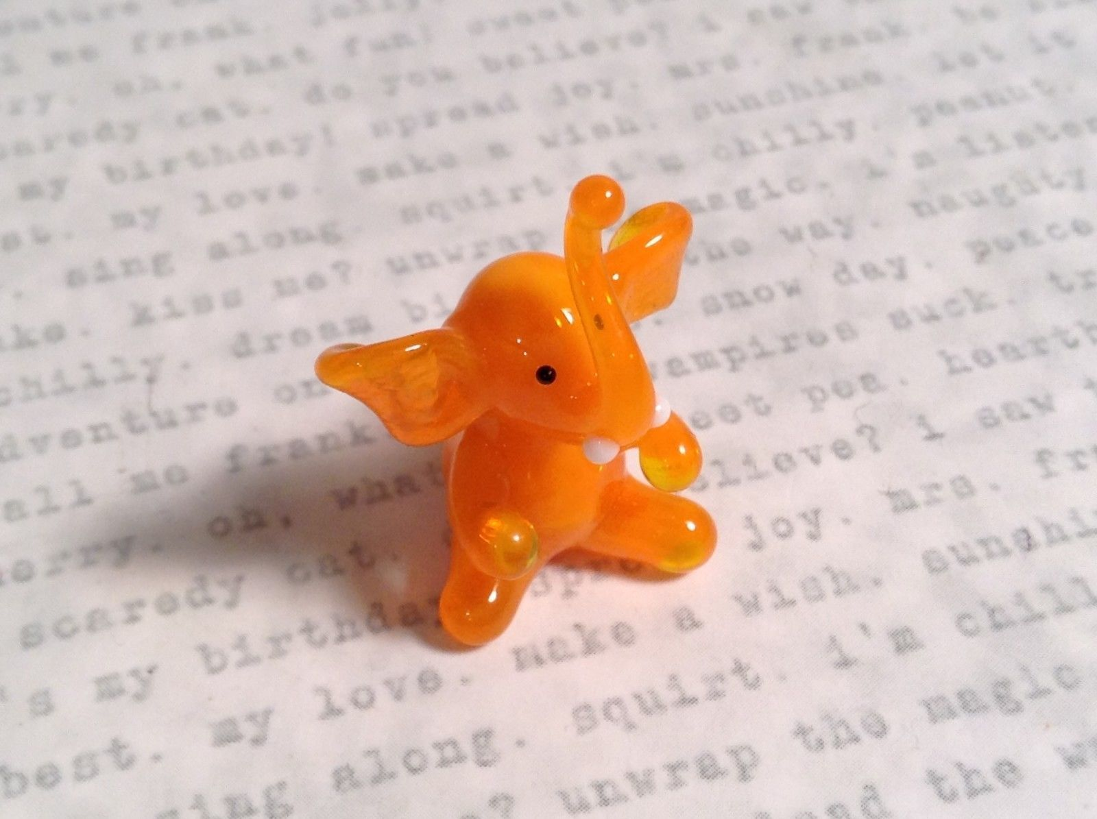 Micro miniature small hand blown glass orange elephant USA made