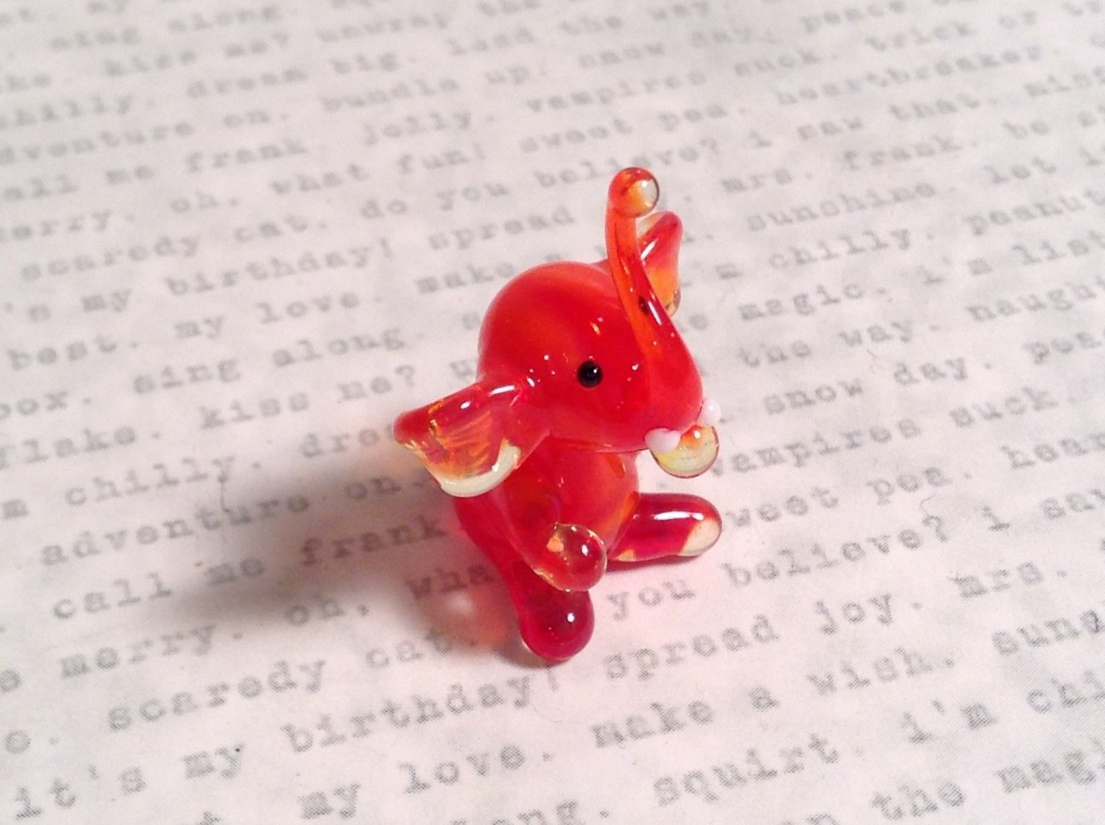 Micro miniature small hand blown glass red amber sitting elephant USA made