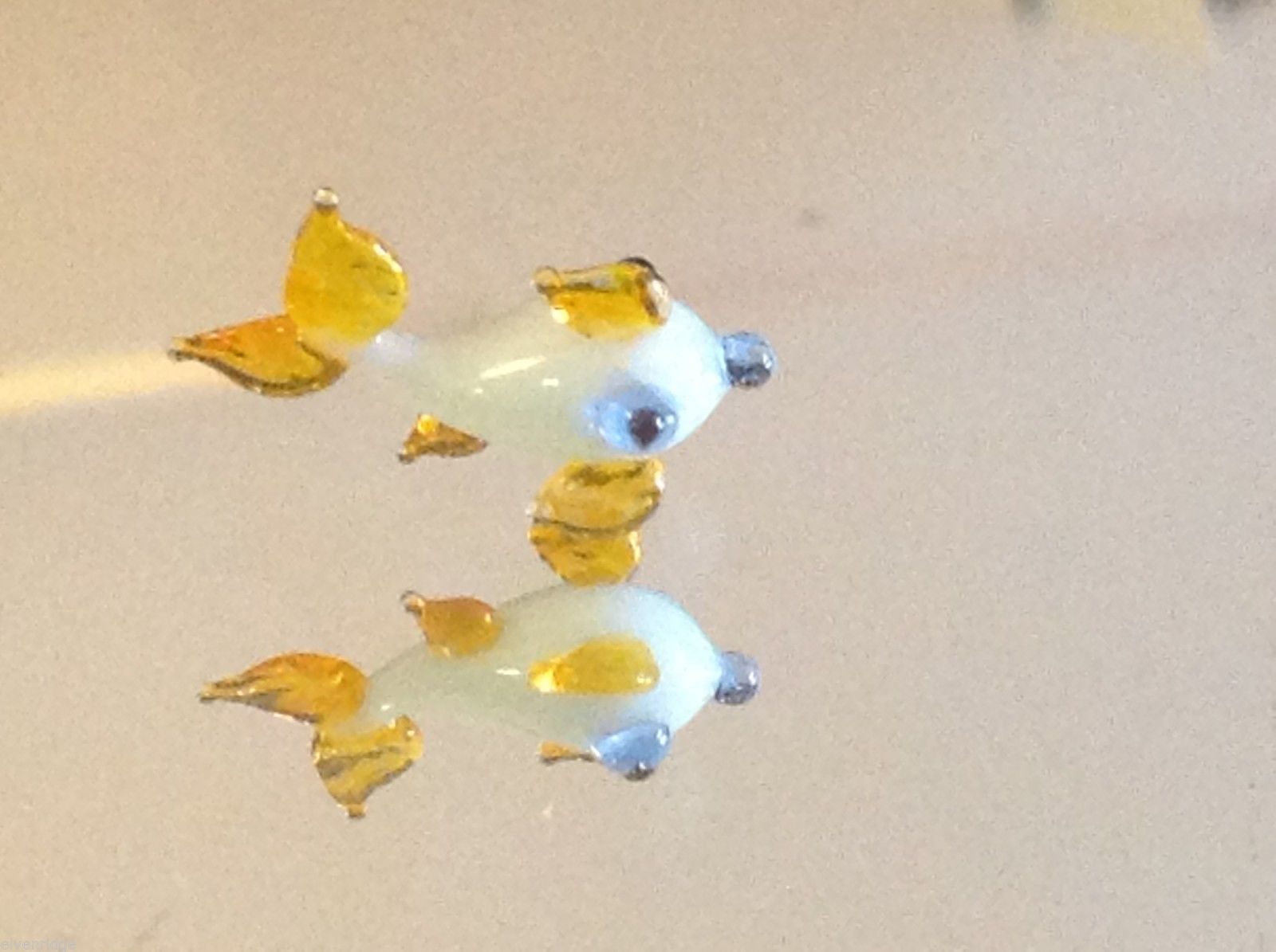 Micro miniature small hand blown glass white fish with yellow fins