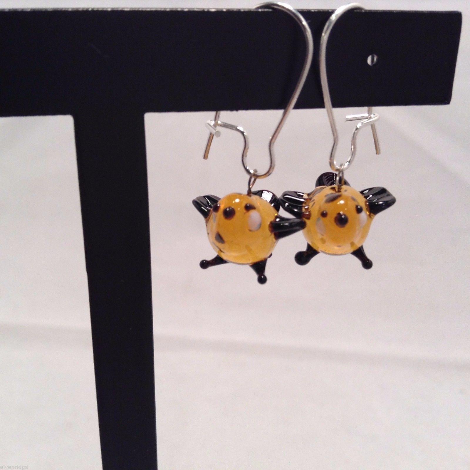 Miniature small hand blown glass made USA NIB orange black bird  earrings