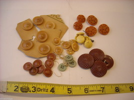 Mixed lot of black vintage buttons molded in brown yellow green image 1
