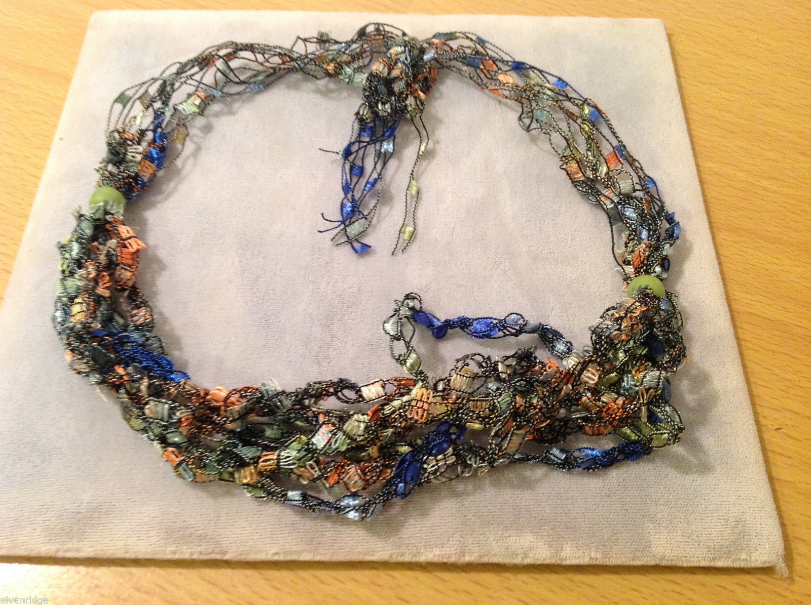 Multi Colored fabric threads necklace / headband / scarf with two green beads