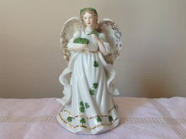 Music Box Angel White Angel Holding Clovers Gold Outlining by Raman Incorporated