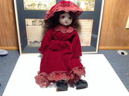 Porcelain Girl Doll with Hat and Red Dress Collectible Intricate