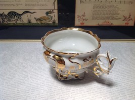 Porcelain White Tea Cup with Gold Tone Accents Intricate Rim and Handle