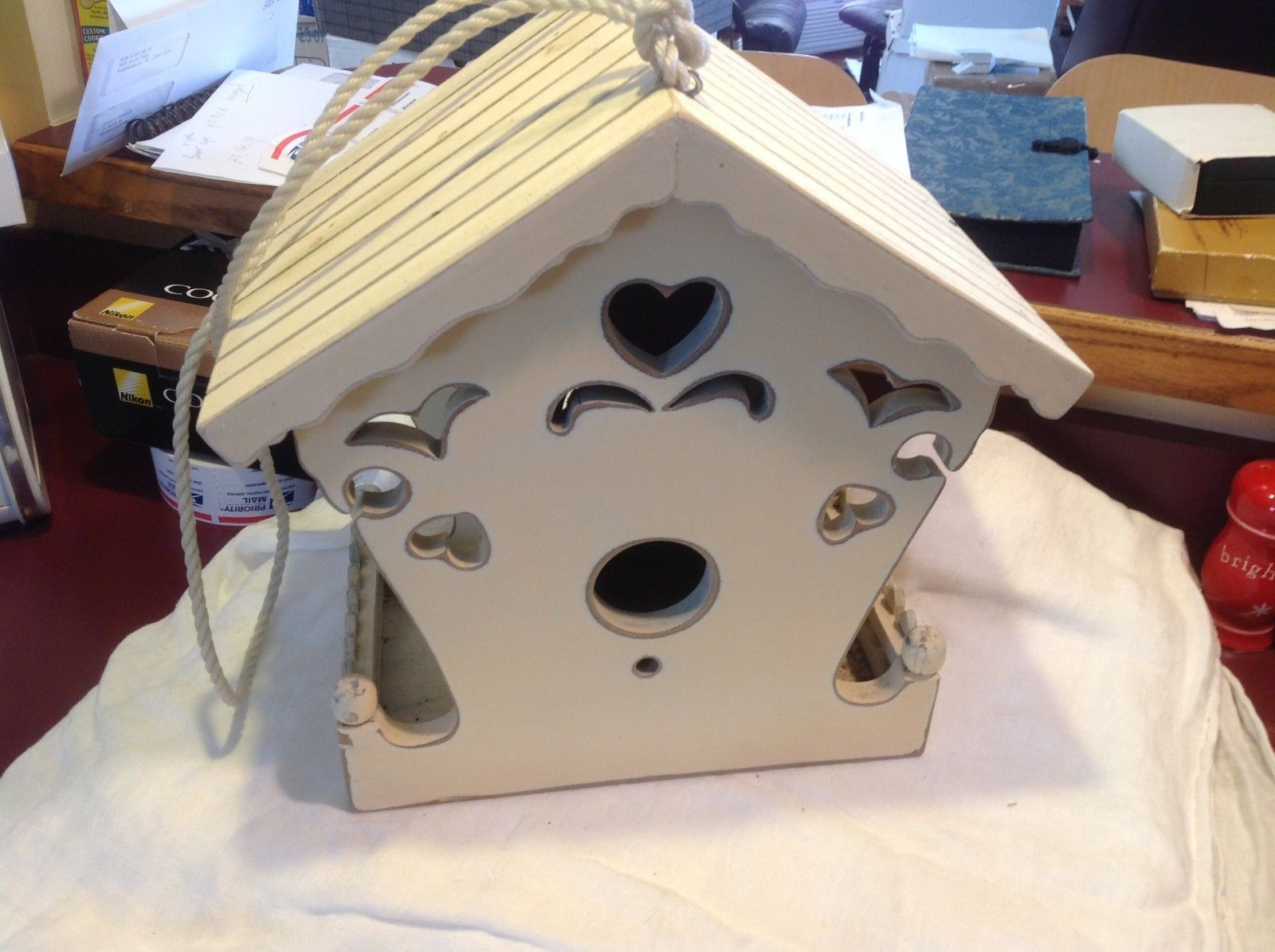 New birdhouse never used stored in the barn cream with hearts