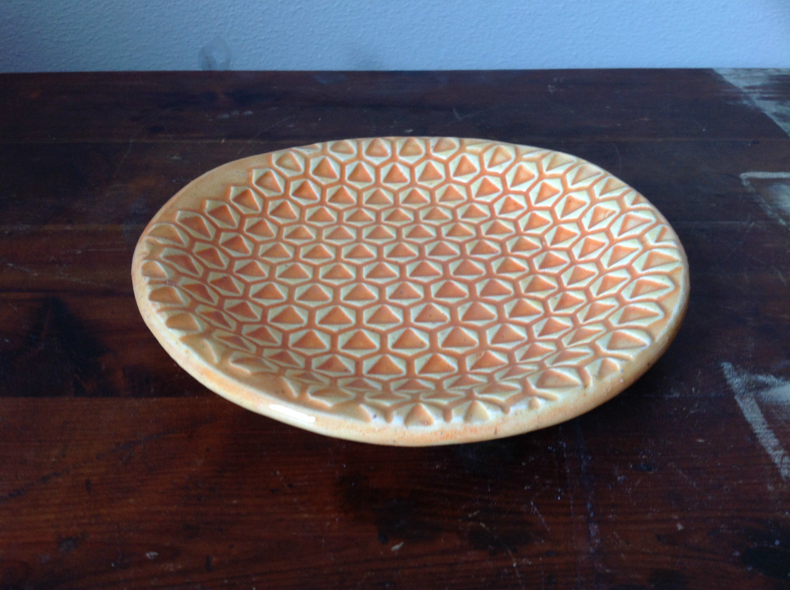 Orange Ceramic Artisan Handcrafted Plate Saucer Interesting Triangular Pattern