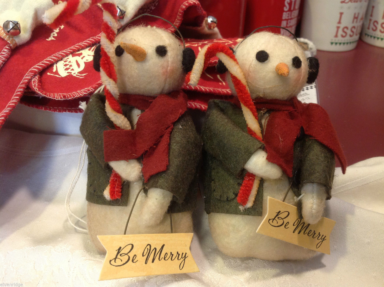 Pair of too cute felted snowman w candy canes and Be Merry Sign jacket and scarf