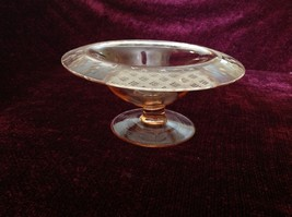 Pink Glass Raised Display Bowl with Etched Flowers and Other Designs on Rim