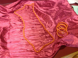 Pretty long orange (22 inches) necklace with bracelets (4 inches)