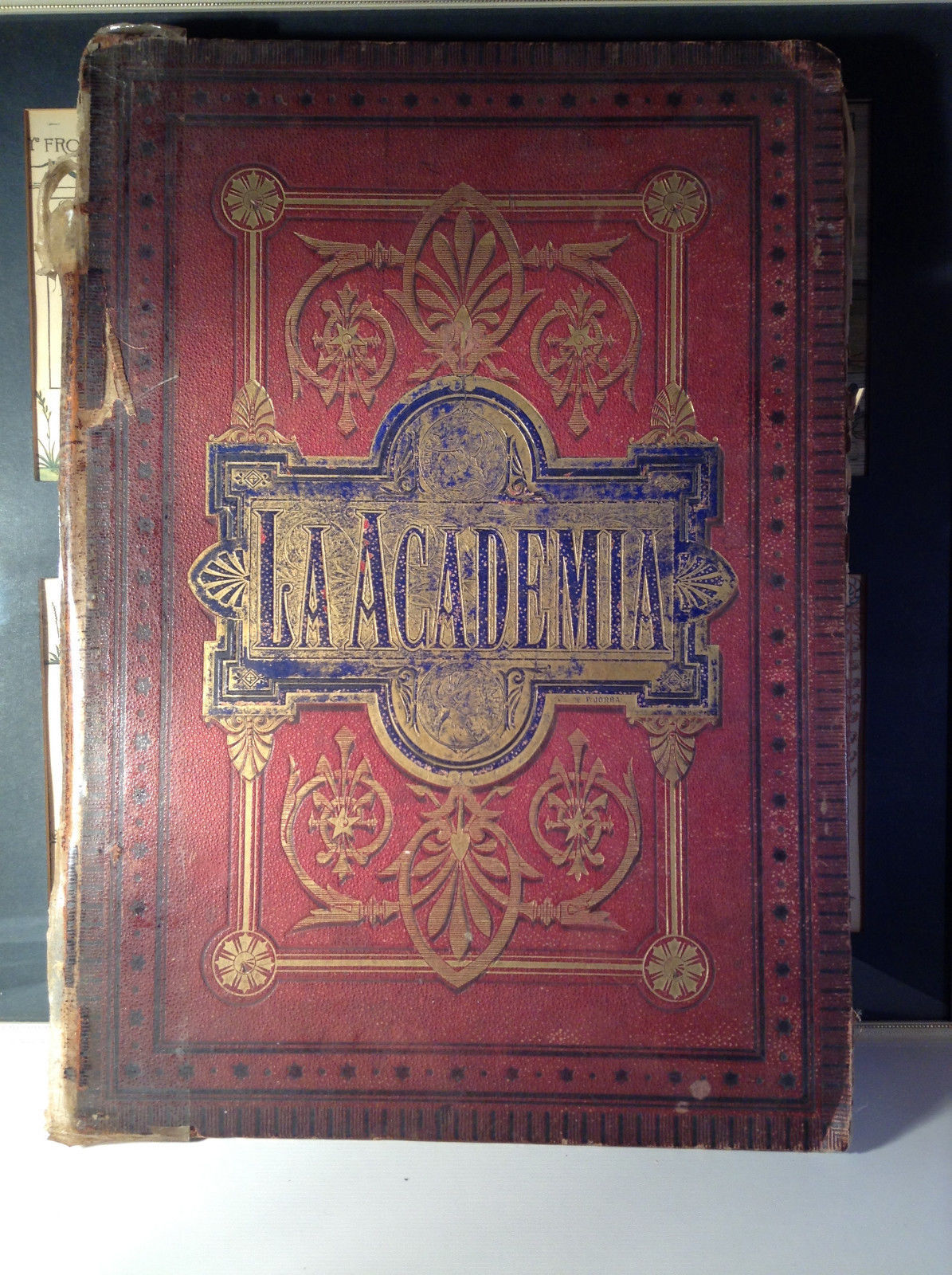 Red L Academia 1877 Spanish Book Appears to be Encyclopedia or Reference Book