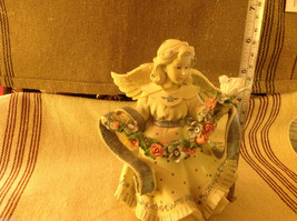 Angel Figurine with garland of colorful flowers and bird image 2