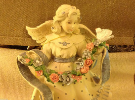 Angel Figurine with garland of colorful flowers and bird image 6