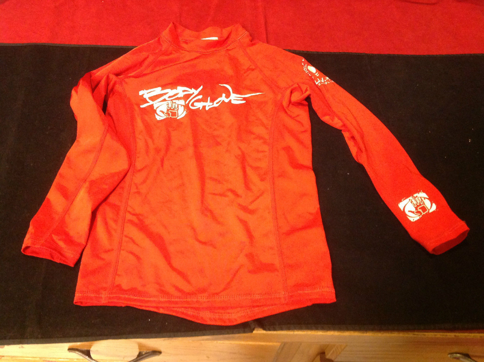 Red colored long sleeve Body Glove shirt