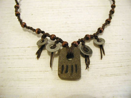 Repurposed tribal punk hand knotted necklace with metal artifacts engraved