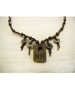 Repurposed tribal punk hand knotted necklace with metal artifacts engraved - $89.09