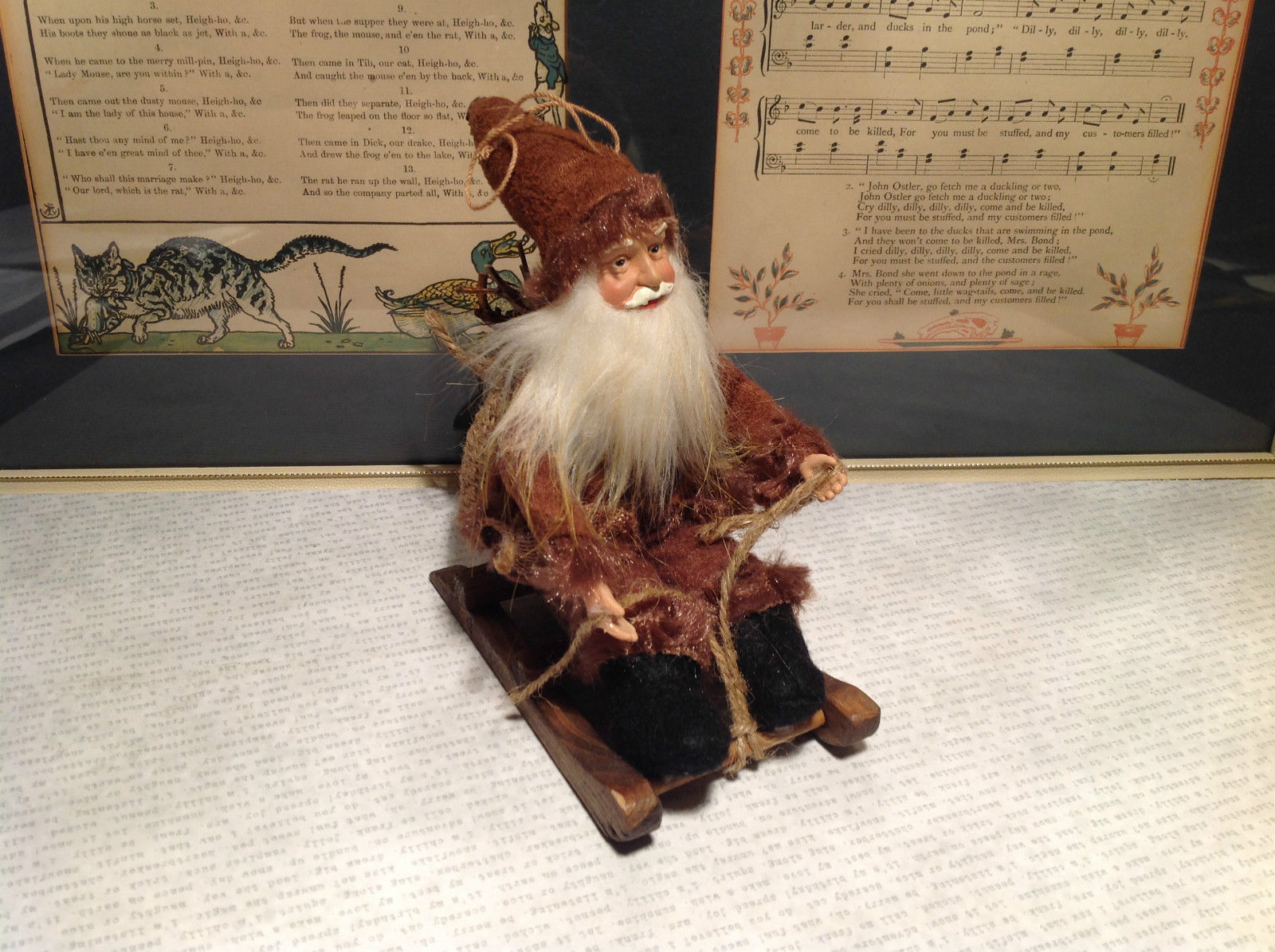 Santa with Burlap Sack on Back in Brown Wooden Sled Figurine Ornament