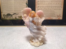 Seraphim Classics Celeste Light of the World Angel Figurine Angel Holding Baby