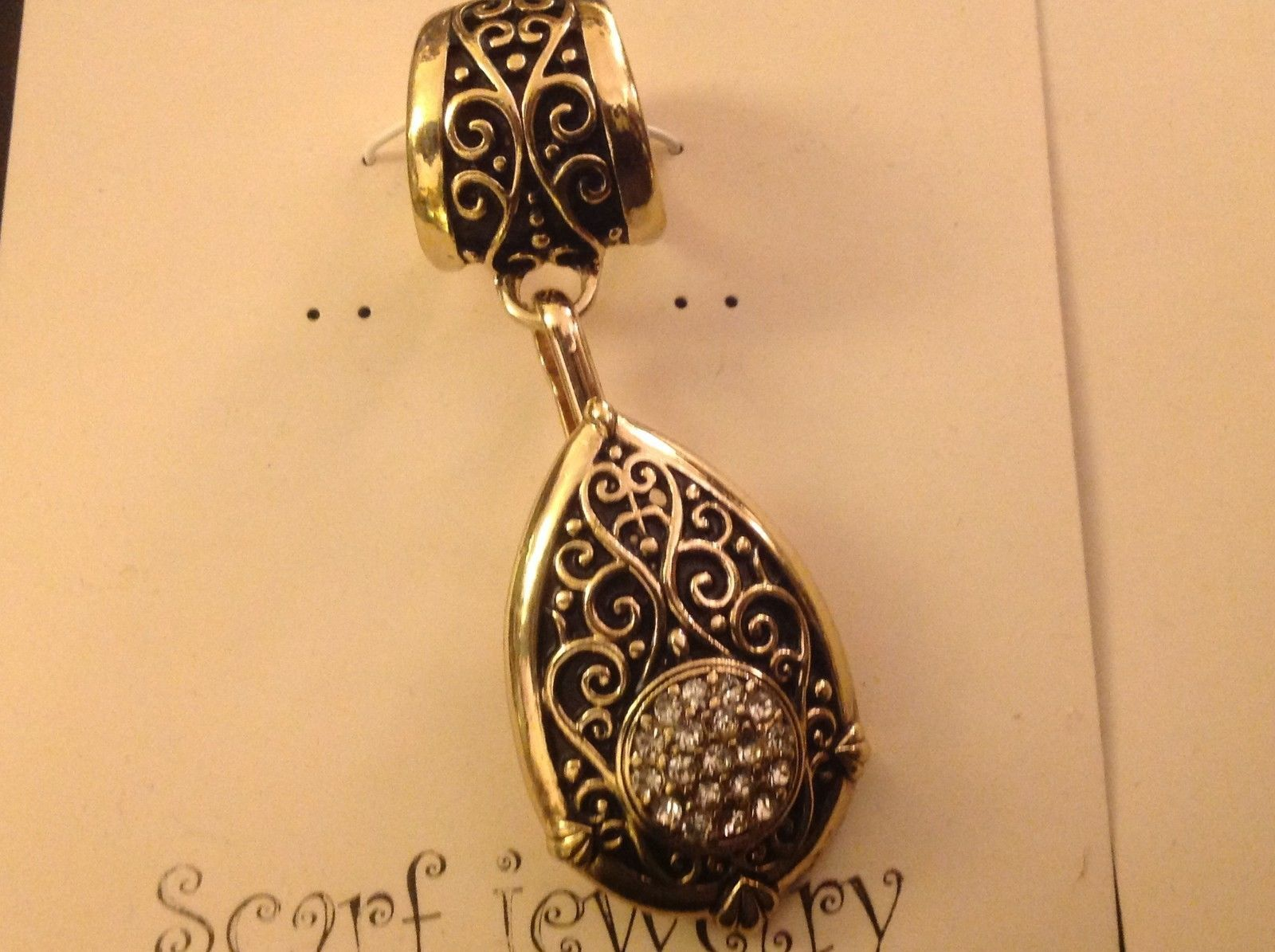 Scarf pendant gold tone enamel embossed relief and crystal studded tear drop