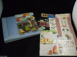 Scrapbook Album with Various Stickers and Scrapbooking Items image 1