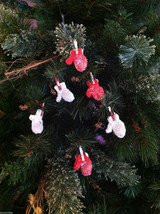 Set of 6 Glittery Red and White Mitten ornaments hanging from Clothespin