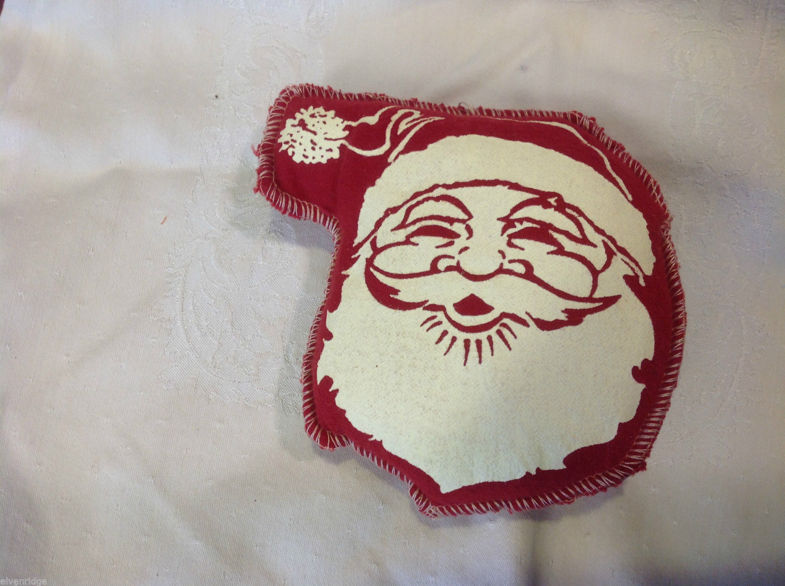 Set of 6 red felt Santa head puffy pillow ornaments in traditional stamp style