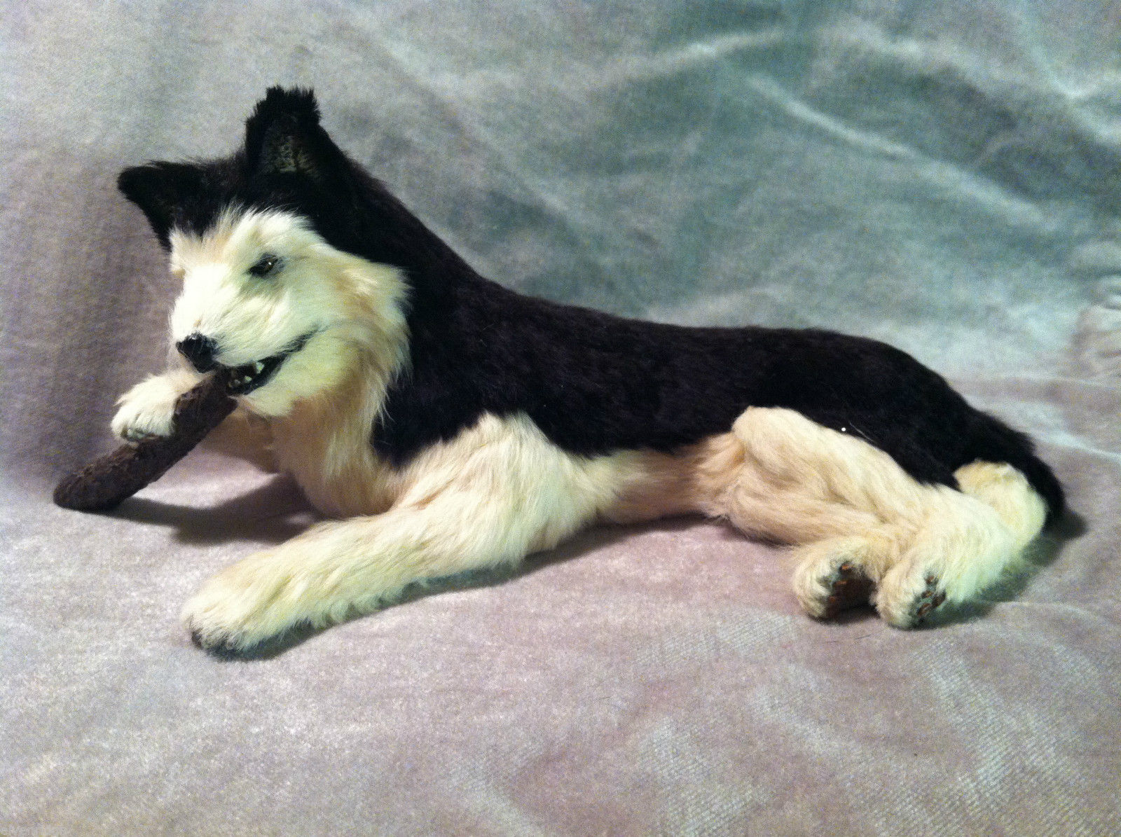 Siberian Husky chewing on stick - Dog Figurine - recycled rabbit fur