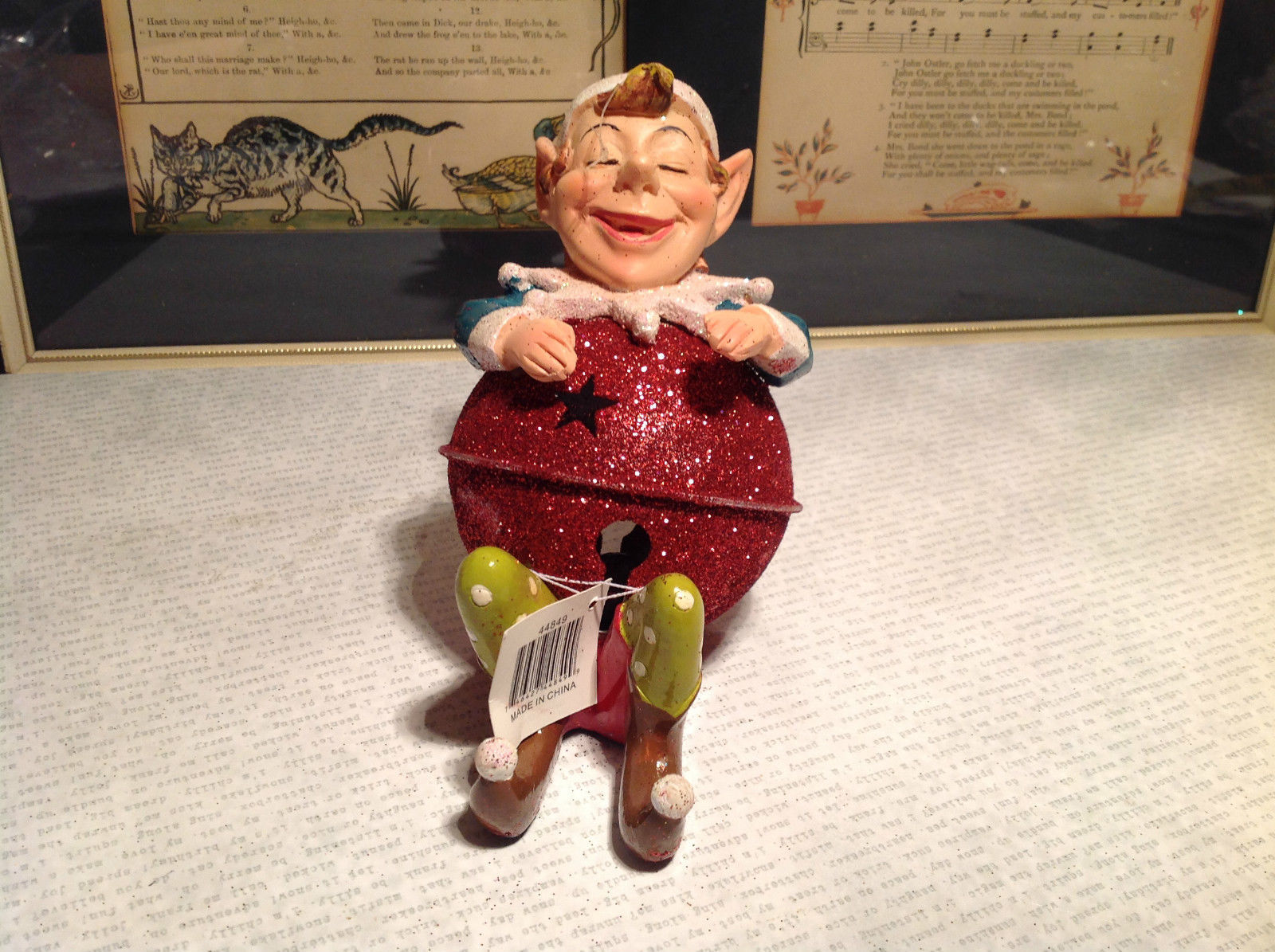 Sitting Smiling Metal and Resin Ornament Figurine Glitter Orb Height 5 Inches