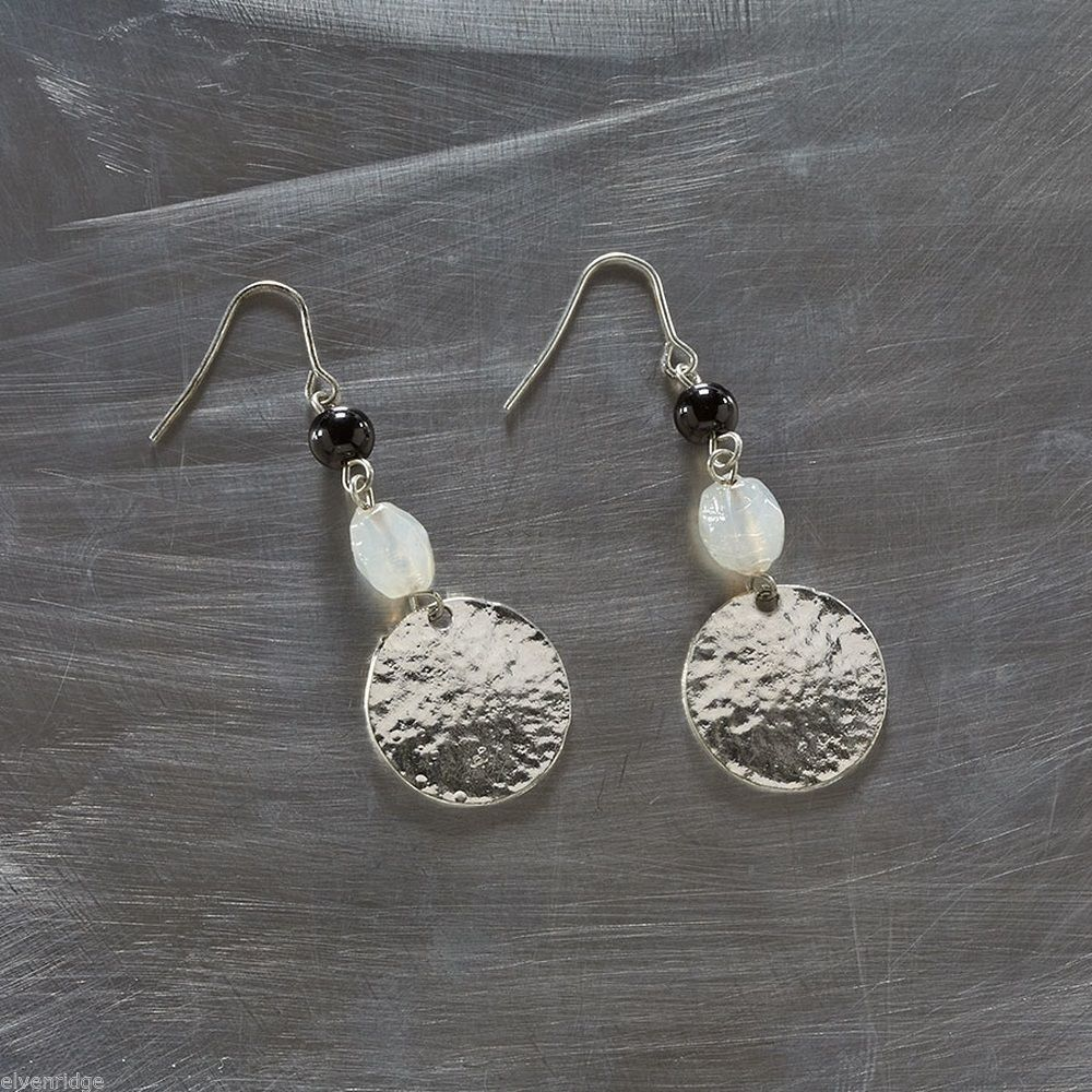 Silver tone hammered disc earrings