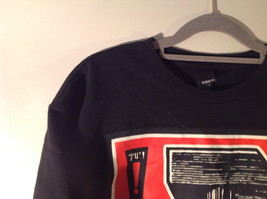 OBEY Black T Shirt White Dostain Picture on Front Red Star Fist Size Medium image 6