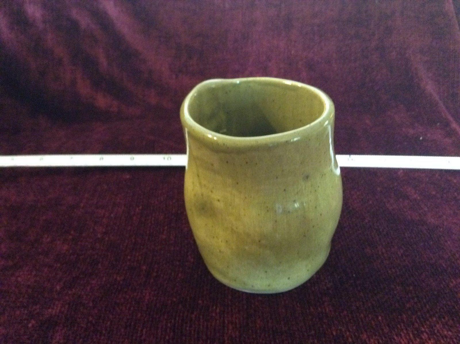 Small Green Ceramic 2012 Vase Designs on Bottom Base