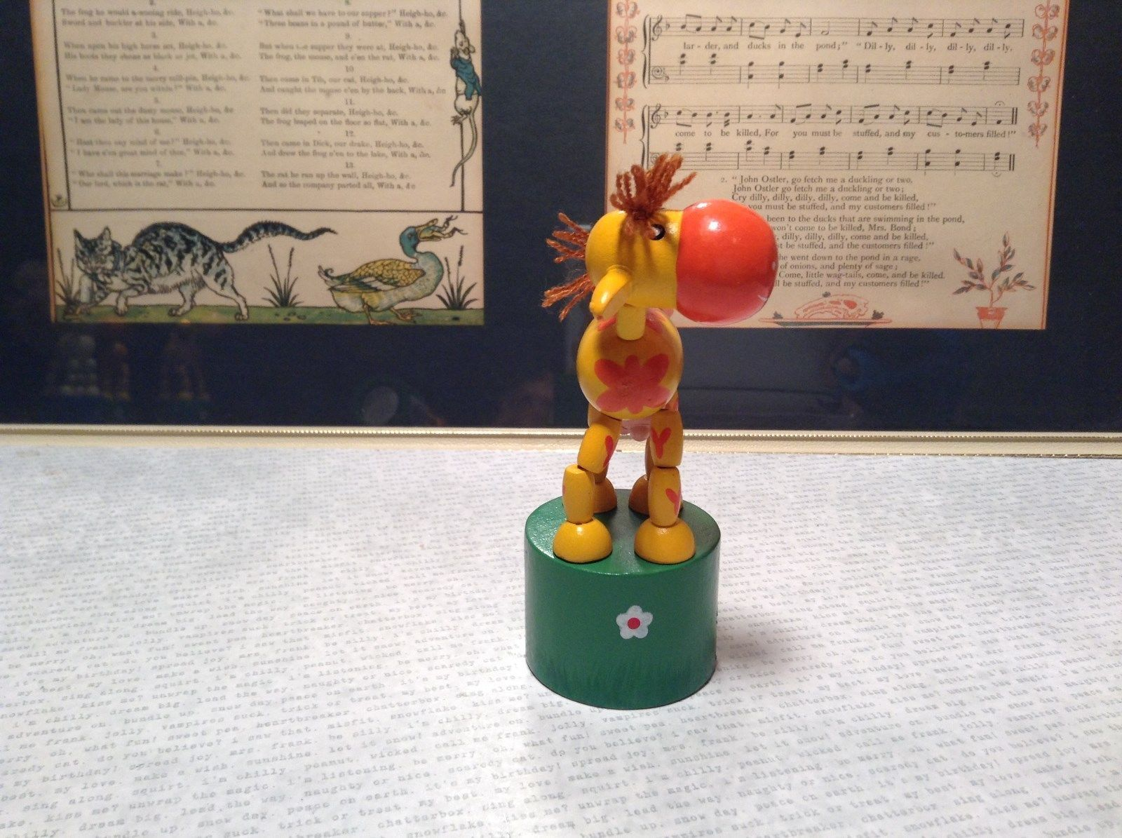 Small Childrens Wooden Yellow Cow String Toy on Green Base Push Bottom Action