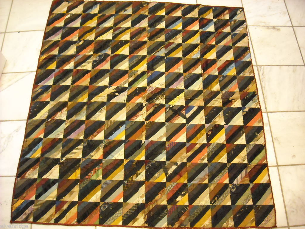 Small  antique quilt with silk fabrics diagonal stripes