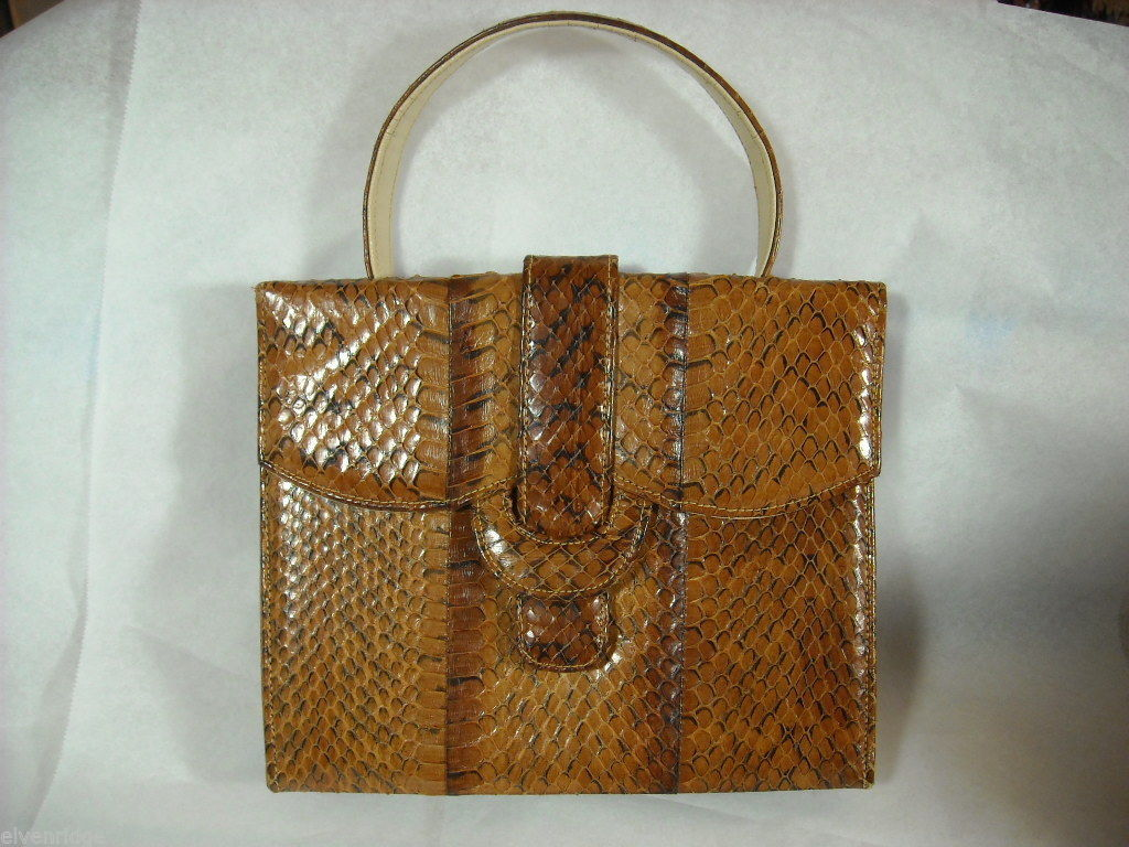 Small handled vintage purse with reptilian look outer surface and snap clasp