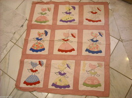 Small crib quilt with girls in each frame