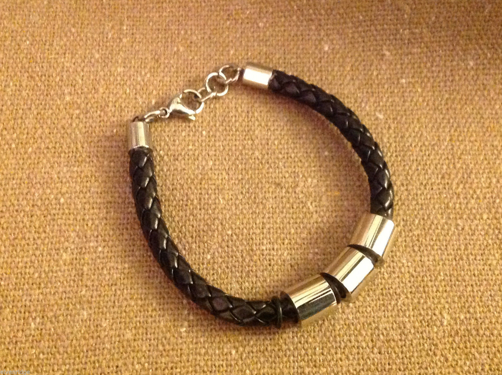 Smooth leather woven bracelet with titanium plated beads and lobster closure