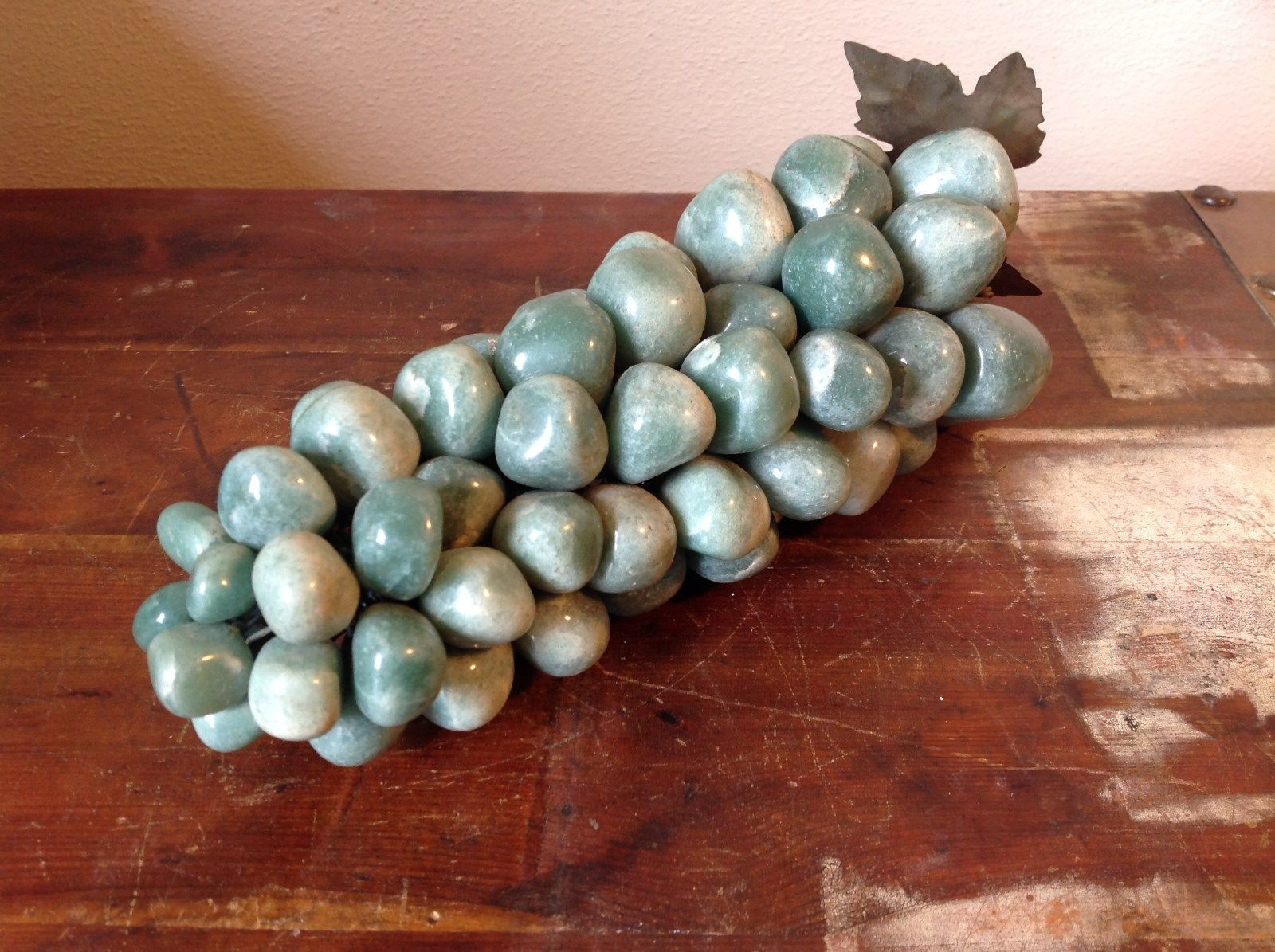 Stone Garden Ornament Resembles Grape Vines Green Stones with Metal Leaf on Top